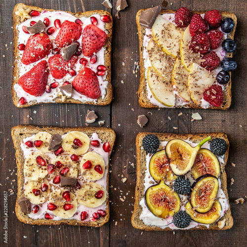 Foto Murales Healthy breakfast. Slices of wholegrain toasts with cream cheese, various fruit, seeds and nuts. Top view.