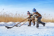Boys play hockey on a frozen lake