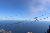 Father and son are on the suspension bridge at an altitude of 1234 meters