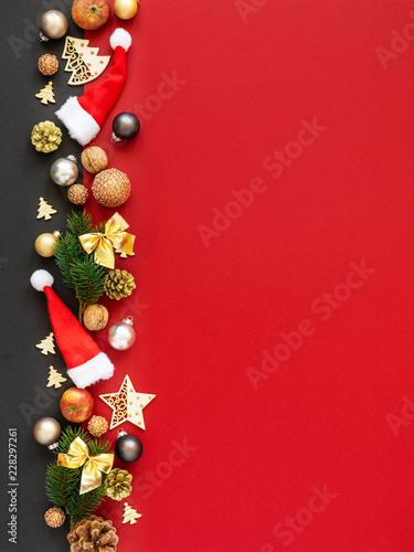 fototapeta na ścianę Christmas decoration background red with santa hats glass balls twig apples nuts