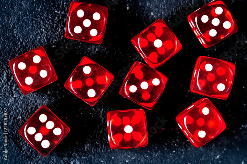 Sticker risk concept playing dice at dark background top view