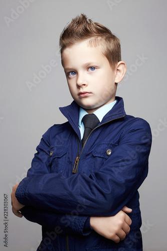 Leinwandbild Motiv fashionable little boy. fashion hairstyle child portrait