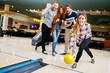 Leinwandbild Motiv Friends enjoying bowling at club