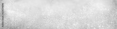 Foto Murales Abstract of Bright and sparkling bokeh background. silver and diamond dust bokeh blurred lighting from glitter texture