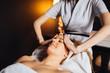 Leinwanddruck Bild - Beautiful young and cute woman enjoying massage treatment