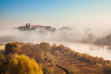 Abbey Tyniec surrounded by meandering Vistula river in colorful autumn scenery. Worth seeing nature reserve of Krakow - 228343429