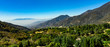Aerial, drone view of Oak Glen located between the San Bernardino Mountains and Little San Bernardino Mountains with several apple orchards before the Fall color change - 228355669