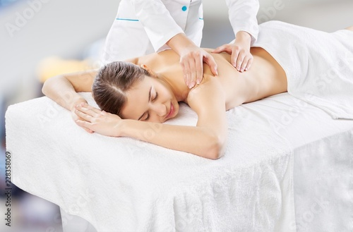 Leinwanddruck Bild Beautiful young woman relaxing with massage at beauty spa