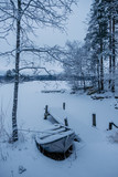 Frozen and covered by snow boat  - 228390078