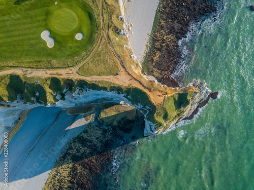 Leinwanddruck Bild Drone view of a golf field next to the ocean in Etretat France