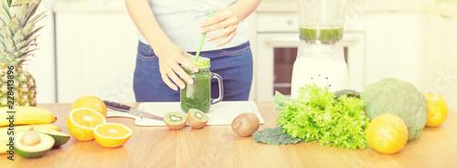 Preparing detox fruits smoothie in blender