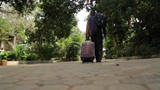 a traveler walking pulling briefcase long journey starts with a step to your destination - 228425612