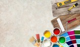 Paint brushes and paint cans for  repair on wooden background - 228447239