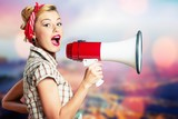 Portrait of woman holding megaphone, dressed in - 228448297