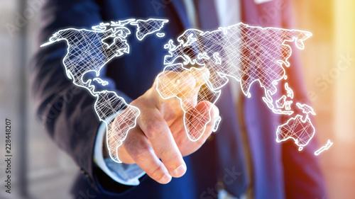 Businessman holding a Hand drawn world map on a futuristic interface