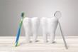 Big teeth, toothbrush and dentist mirror in