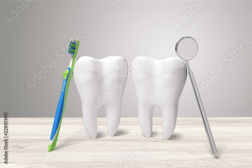 Big teeth, toothbrush and dentist mirror in - 228451461