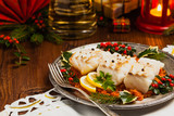 Christmas fish. Roasted cod pieces, served in vegetable sauce. - 228456877