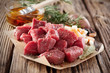Leinwanddruck Bild - Uncooked fresh diced seasoned meat with herbs