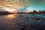 Dramatic Sunset By The River - 228473279