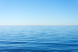 Quiet calm surface of water, sea and horizon and clear sky.