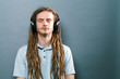 Man listening to headphones on a solid background