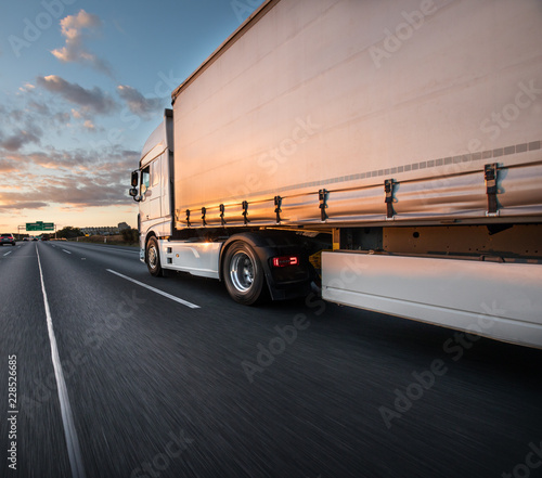 Leinwanddruck Bild Truck with container on road, cargo transportation concept.