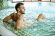 Quadro Handsome young man relaxing in hot tub