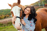A Woman with her horse at sunset, autumn outdoors scene - 228541655