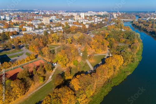 Fridge magnet Public Park and River Neris in Vilnius, Lithuania. Autumn.