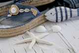 still life with blue denim sandal, fish and starfish - 228575213