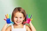Little girl showing painted hands on  background - 228582881