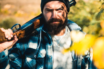 Poacher in the Forest. Hunting Licenses. Hunting is the practice of killing or trapping animals. Hunter with shotgun gun on hunt. Closed and open hunting season.