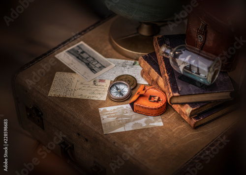 Old letters and compass isolated on vintage suitcase © marina