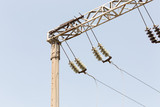 Railway electrification system. Overhead line wire over rail track. Power lines.