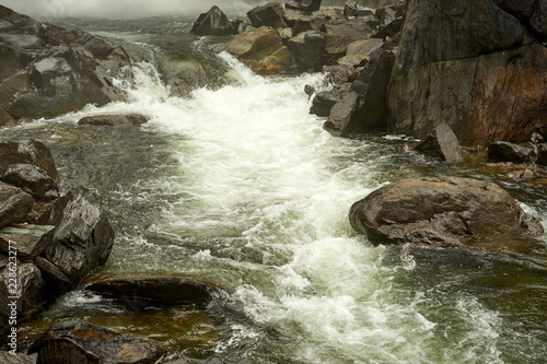 rever flowing in rocks - 228623277