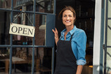 Woman at small business entrance - 228645039