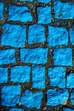 blue painted cobblestones, parking for handicapped - 228646468