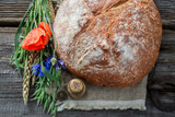 Homemade bread with poppies, wheat and ears