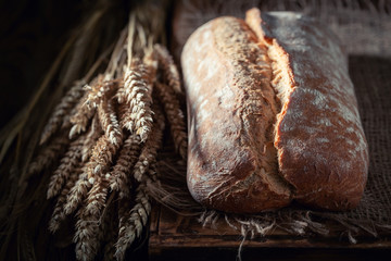 Homemade loaf of bread in rustic kitchen