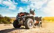 Leinwandbild Motiv Summer offroad adventure on atv in sand quarry