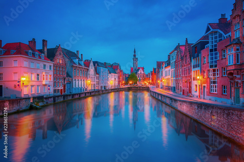 Sticker Scenic city view of Bruges canal with beautiful medieval colored houses, bridge and reflections in the evening, Belgium