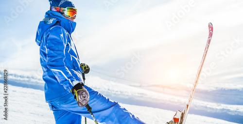 Leinwanddruck Bild Male athlete skiing in snow mountains on weekend holidays