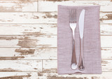 cutlery and napkin on wooden table. Mock up napkins for design. Napkins top view square. - 228667661