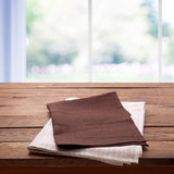 Napkin on the table and kitchen window blurred background - 228669409