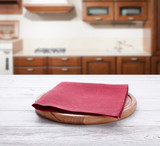 Empty pizza board with tablecloth on the table and kitchen interior blurred background - 228669606