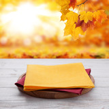 Pizza board with towel on wooden desk. Autumn background. Top view mock up. Selective focus. - 228669617