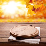 Pizza board with towel on wooden desk. Autumn background. Top view mock up. Selective focus. - 228669858