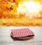 Napkin. Stack of colorful dish towels on wooden table and autumn background. Top view mock up - 228673449