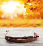 Napkin. Stack of colorful dish towels on wooden table and autumn background. Top view mock up - 228673475